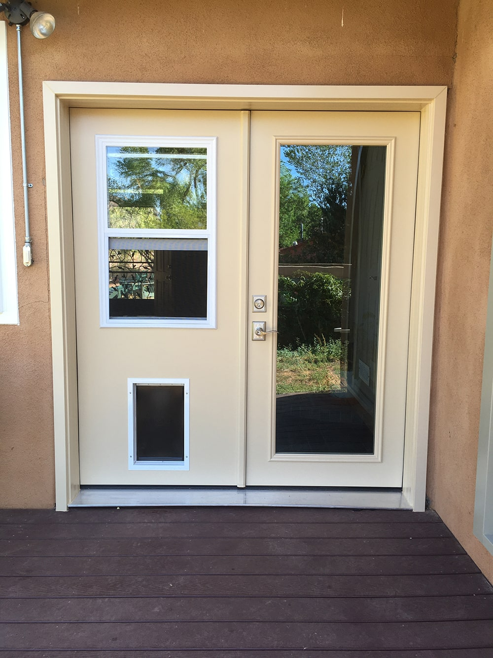 Swinging Patio Doors with Pet Door Installation